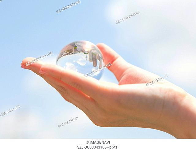 Close up of hand holding sphere