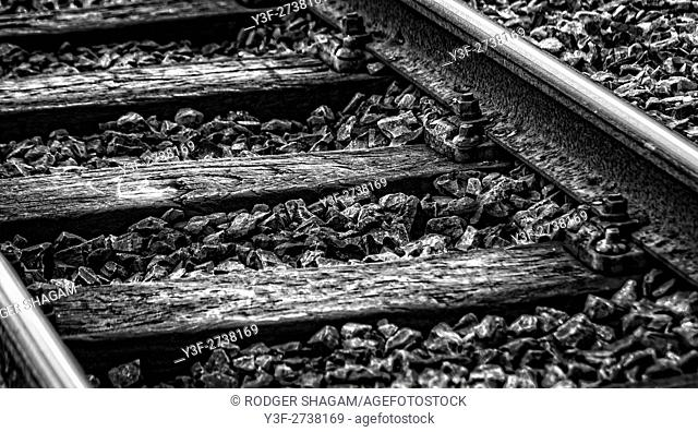 Railroad track with old wooden sleepers. Southern Suburbs Line, Cape Town, South Africa