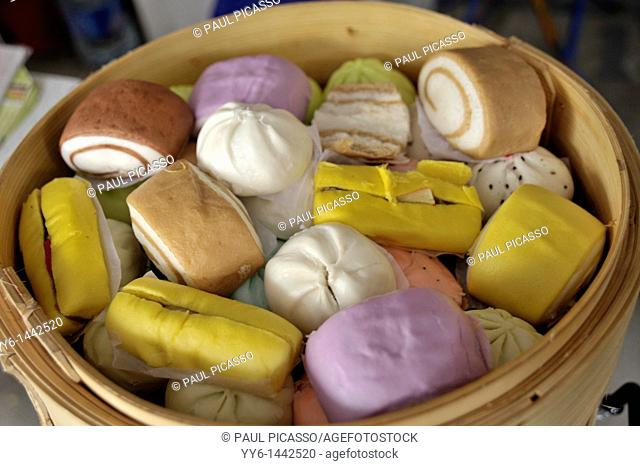 chinese colourful buns and cakes , chinese delicacy, chinatown , bangkok, thailand