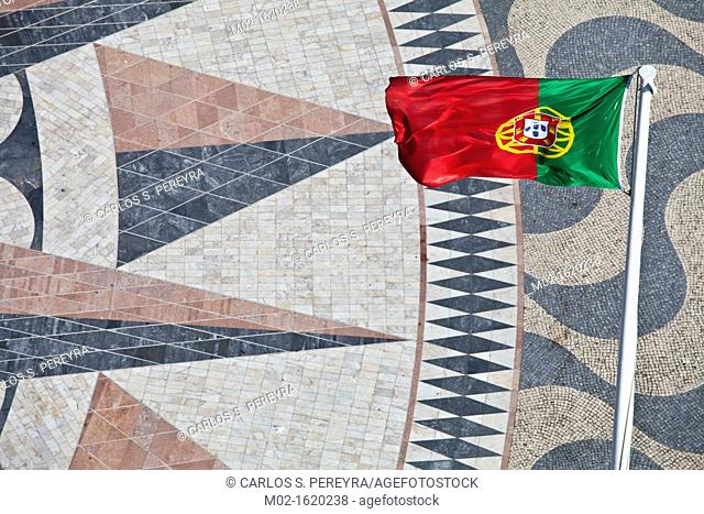 Flag of Portugal and a giant world map at the foot of the Monument to the Discoveries, Padrao dos Descobrimentos, Belem, Lisbon, Portugal, Europe