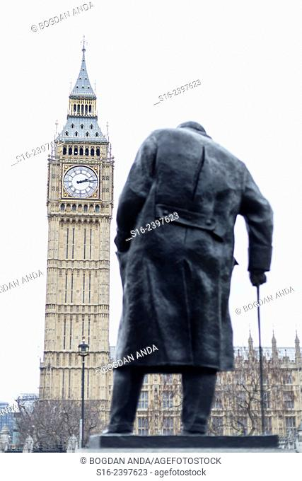 London - Winston Churchill's statue in Parliament Square, with Elizabeth Tower (Big Ben) and the Houses of Parliament in the background