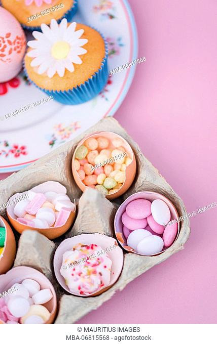 Eggshells filled with sweets, still life