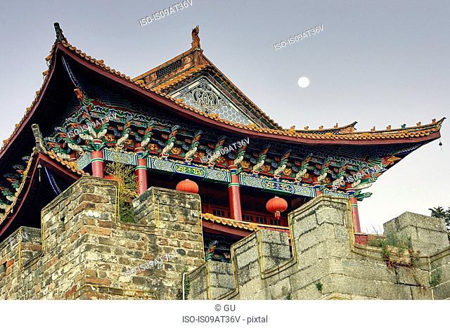 Low angle view of pagoda and full moon, Dali, Yunnan, China
