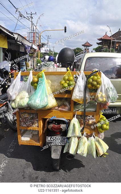 Denpasar (Bali, Indonesia): a food seller on his motor-bike