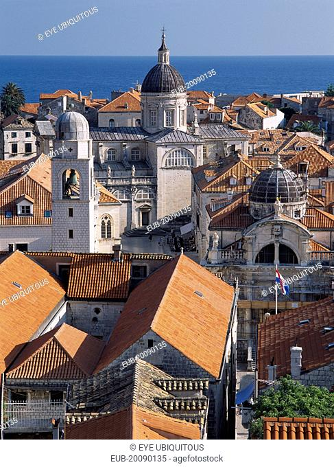 Elevated view across terracotta tiled roof tops in the Old City towards the Cathedral, known as the Church of the Assumption