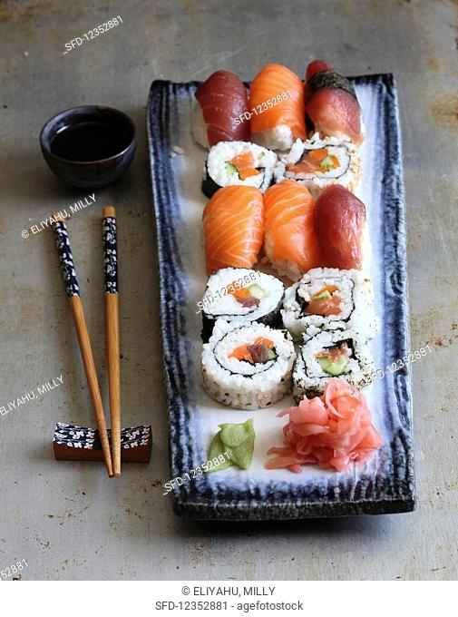 Various types of sushi with wasabi, ginger and soy sauce