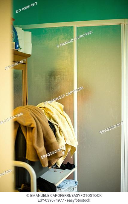 view of the bathroom with shower, woman takes shower