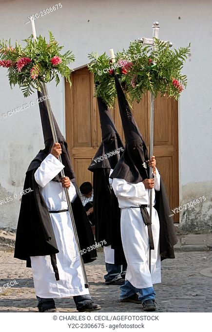 Antigua, Guatemala. Holy Saturday. Nazarenos March in the Procession of the Virgin of Solitude (Virgen de Soledad), Holy Week, La Semana Santa