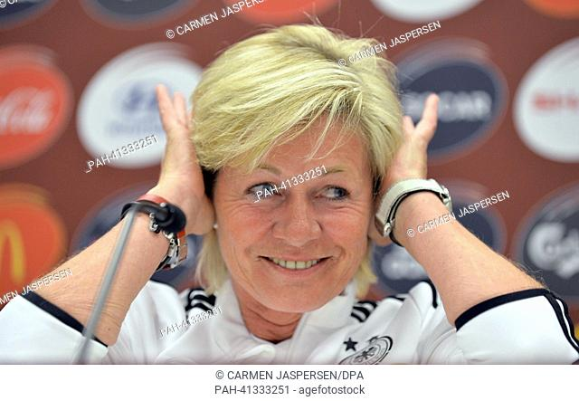 Germany's head coach Silvia Neid sits during the UEFApress conference at the Women's EURO in the press from of Friends Arena in Solnar,Sweden, 27July 2013