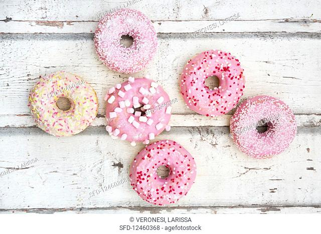 Doughnuts with pink sugar glaze and sugar decorations