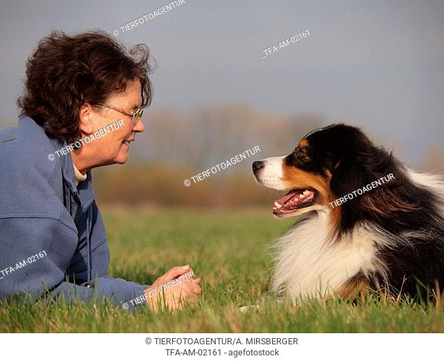 woman and Australian Shepherd