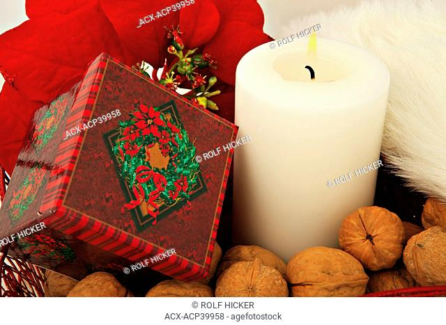 Christmas gifts around a candle with walnuts