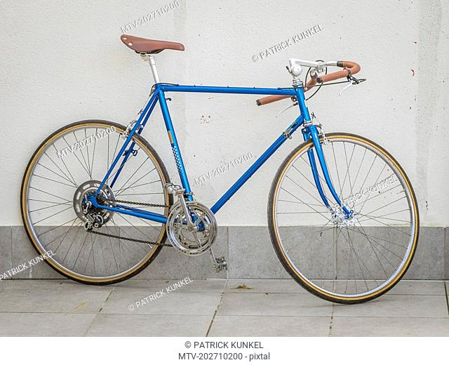 Retro styled bicycle in front of wall
