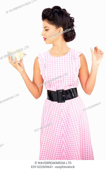 Unsmiling black hair model holding candies