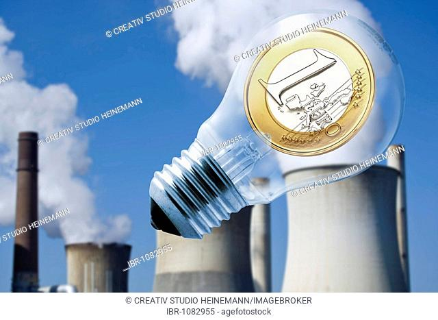 Euro coin in a lightbulb, symbol for energy costs
