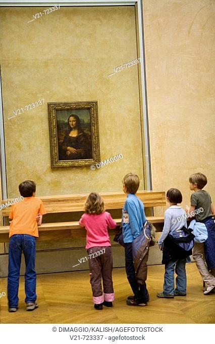 Children at Louvre Museum (Paris, France) viewing the 'Mona Lisa' painting by Leonardo da Vinci