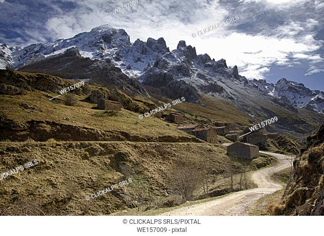 A beautiful road of the village of Vegas del Toro, near Sotres, after a slight late spring snowfall, sotres, bulnes, picos de europa, asturias, spain