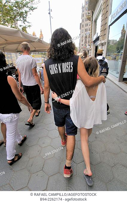 Couple embraced walking. Barcelona. Catalonia. Spain