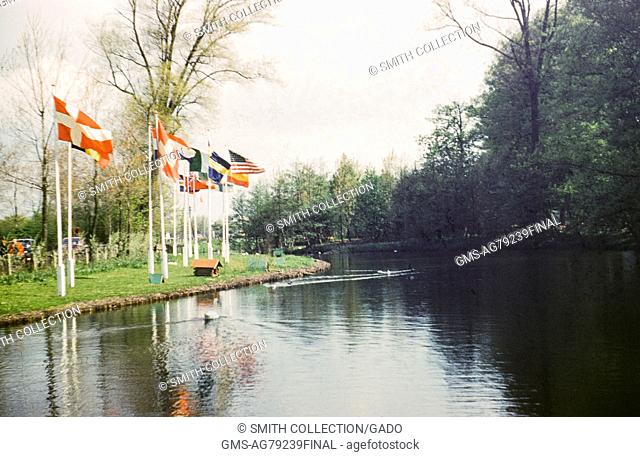 Keukenhof park with flags along a canal, Lisse, Netherlands, 1952