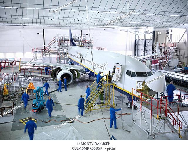 Workers in airplane hangar