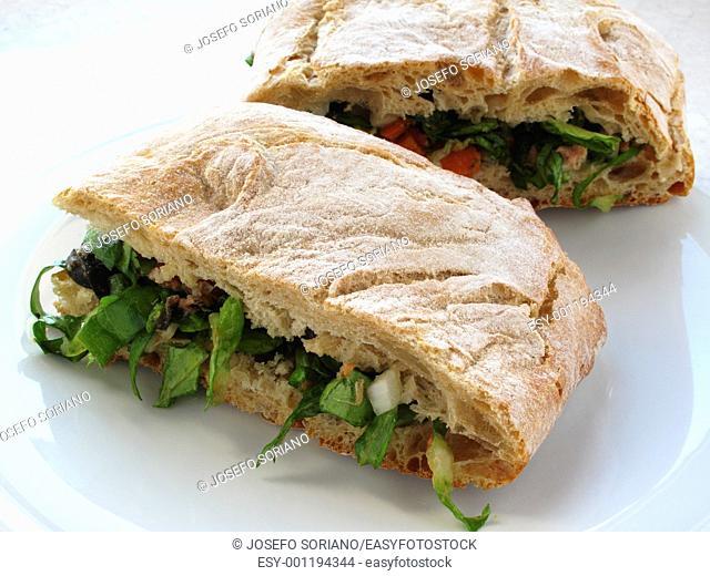 Ciabatta filled with Mediterranean salad