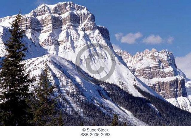 Low angle view of snowcapped mountains, Waputik Range, Banff National Park, Alberta, Canada