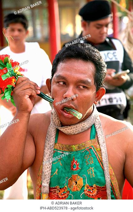 Thailand Phuket Festivals A Mah Jong going through the ritual of face piercing