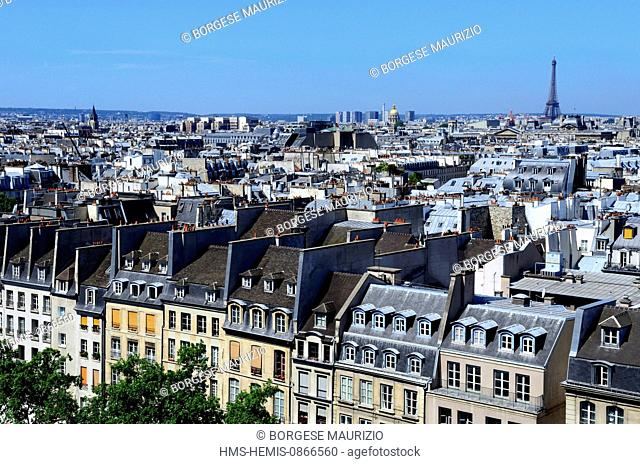 France, Paris, rooftops and the Eiffel Tower in the background seen from the top of Centre Pompidou or Beaubourg, by architects Renzo Piano