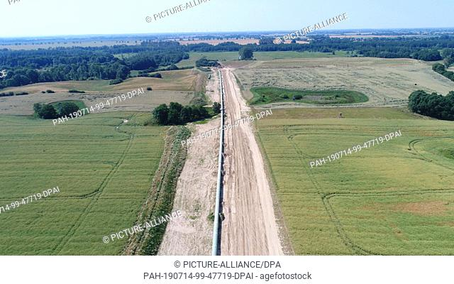 26 June 2019, Mecklenburg-Western Pomerania, Stolpe: A section of the Eugal natural gas pipeline (European Gas Link Pipeline) is ready to be laid in the Peene...
