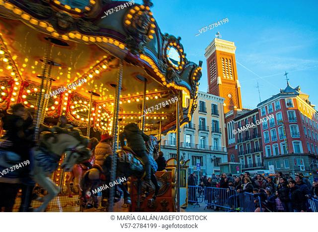 Christmas carousel at Santa Cruz Square. Madrid, Spain