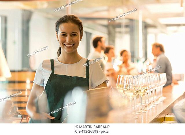 Portrait smiling winery tasting room worker