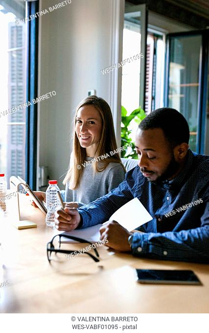 Young man and woman in casual office