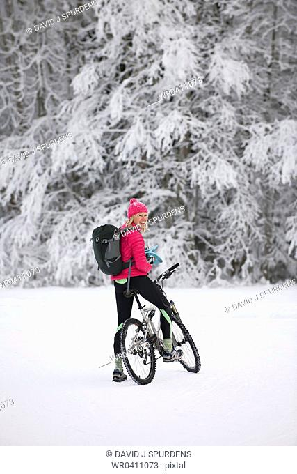 A mountain biker having fun in the snow