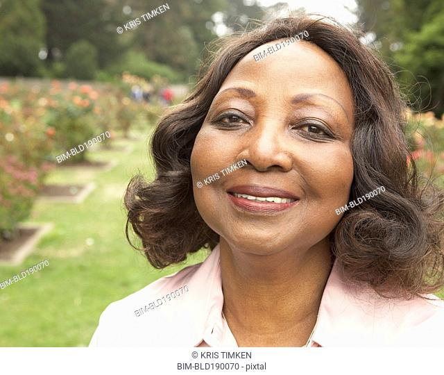 Middle-aged African woman smiling outdoors