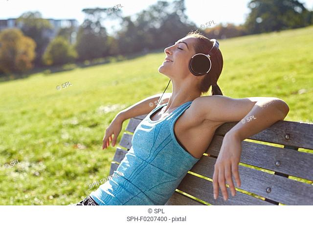 Young woman listening to music from smart phone