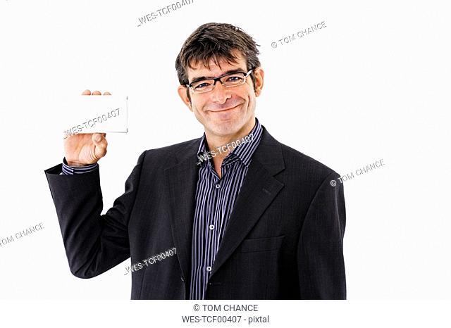 Man holding palmtop, portrait