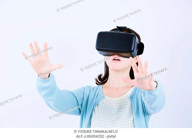 Japanese woman using virtual reality device