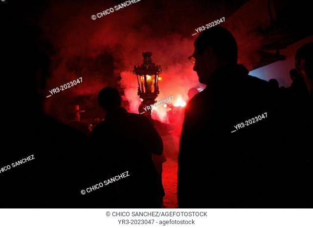 Pilgrims are illuminated by flares during the rosary of the pilgrimage to the shrine of the Virgin of Rocio, in Almonte, Donana National Park, Huelva province