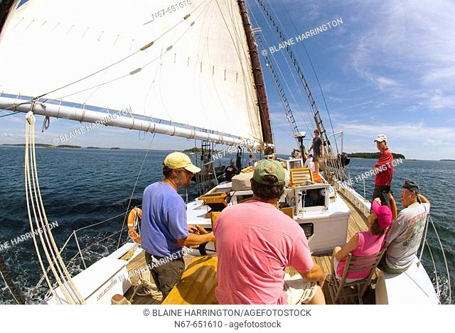 On the deck of the Schooner Nathaniel Bowditch sailing in Penobscot Bay, Maine USA