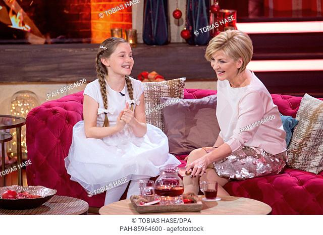 11-year-old composer and musician Alma Deutscher (L) and television host Carmen Nebel seen during the recording of the television show 'Heiligabend mit...
