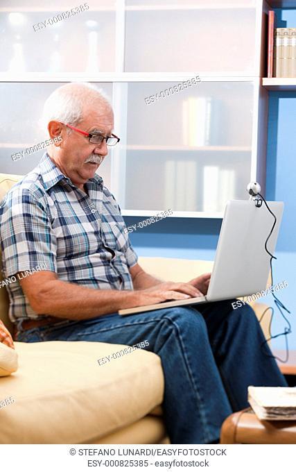 Senior man/Grandfther speaking through webcam