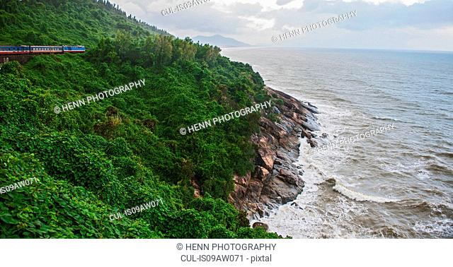 Train on mountain and elevated view sea crashing on rocks, Binh Dinh Province, Vietnam