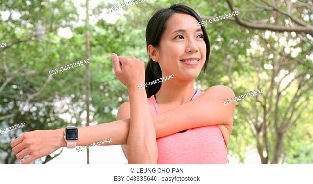 Woman stretching hand at outdoor park