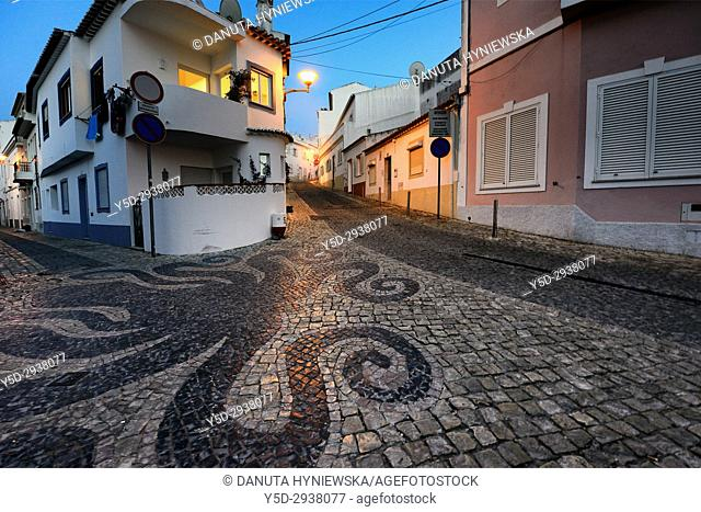 Europe, Portugal, Western Algarve, Faro district , Lagos, street scene at night, old town, Calçada portuguesa in foreground