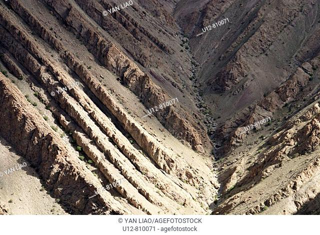 Above the Hemis monastery , on the way to Gozang herimitage are huge slopes of errossion to be seen All carved from glaciers , wind and rain