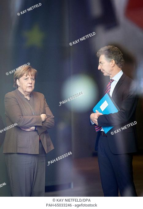 German Chancellor Angela Merkel speaks with her advisor for Foreign and Security Policy, Christoph Heusgen, in the Federal Chancellery in Berlin, Germany