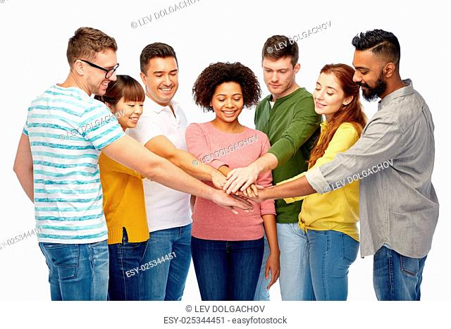 diversity, teamwork, race, ethnicity and people concept - international group of happy smiling men and women holding hands together over white