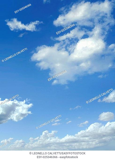 Blue sky with some cumulus white clouds
