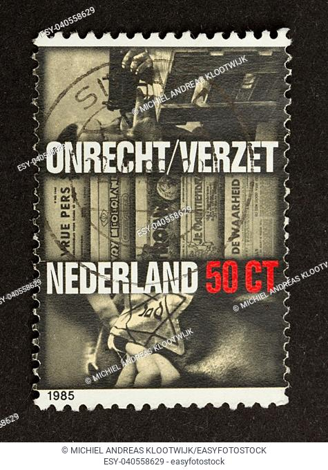 HOLLAND - CIRCA 1970: Stamp printed in the Netherlands shows pictures of the dutch resistance during WWII, circa 1980