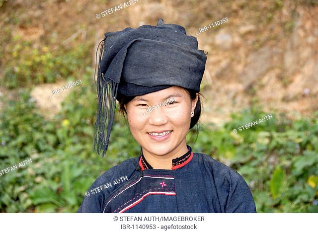 Portrait of a young woman of the Lolo-Hor ethnicity smiling, in traditional costume, Phongsali, Laos, Southeast Asia